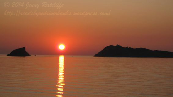 The setting sun between the offshore islands, Lesvos, Greece.