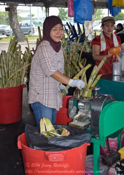 Processing sugar canes to make syrup for the drinks. You don't get fresher than that!