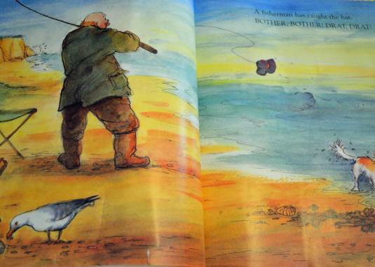 A fisherman, complete with picnic-scavenging seagulls.
